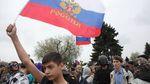 Молодое поколение россиян является потенциальной угрозой для власти Путина, – швейцарское издание
