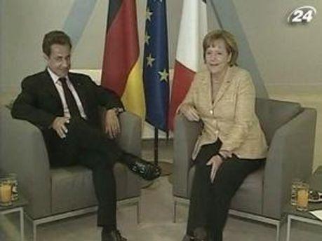 Меркель и Саркози
