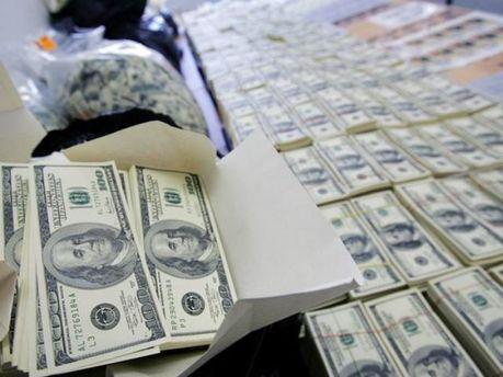 55 млрд долл.. ежегодно выделяется США для других стран