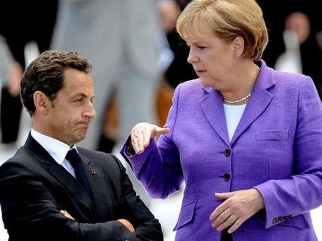 Ангела Меркель пытается переубедить Николя Саркози
