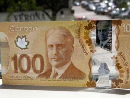 100 канадських доларів