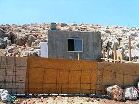 Поселенцы выступают против сноса незаконного жилья