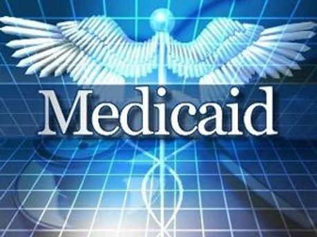 Логотип Medicaid