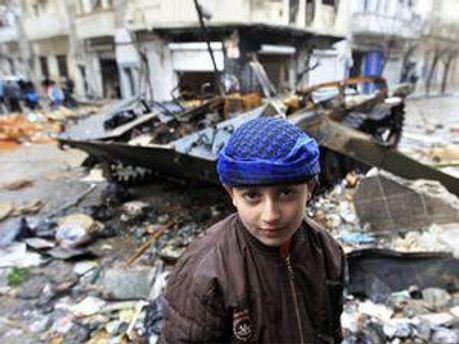 Сирійський хлопчик у Хомсі