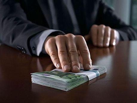 Четверть украинцев занимаются коррупцией