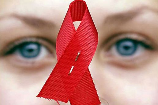 Червона стрічка - символ підтримки ВІЛ-інфікованих
