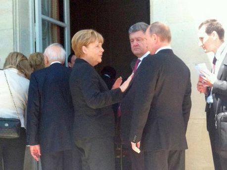 Владимир Путин, Ангела Меркель и Петр Порошенко