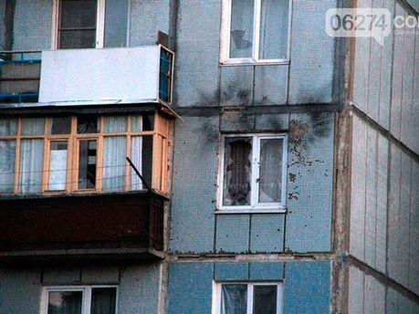 Обстреляный дом