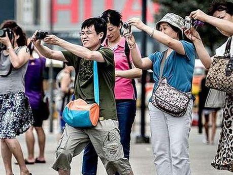 Туристи з Китаю