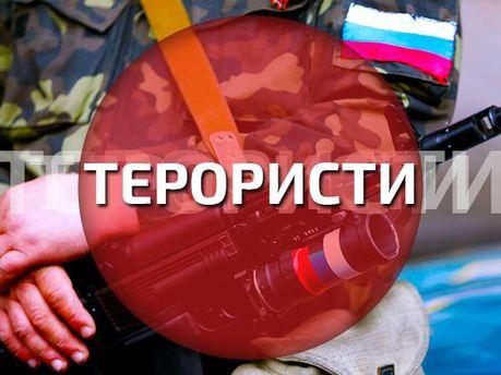 По центру Донецка разгуливают вооруженные террористы