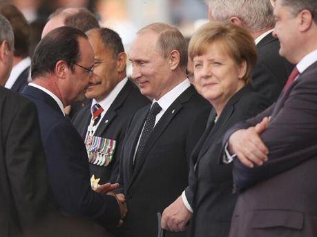 Франсуа Олланд, Володимир Путін, Ангела Меркель і Петро Порошенко