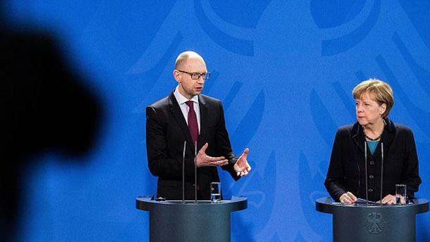 Арсеній Яценюк та Ангела Меркель
