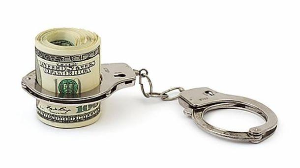 Гроші та кайданки