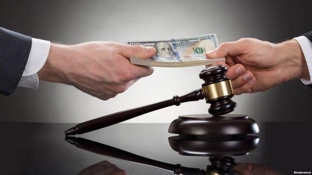 Прокурор та адвокат піймалися на хабарі