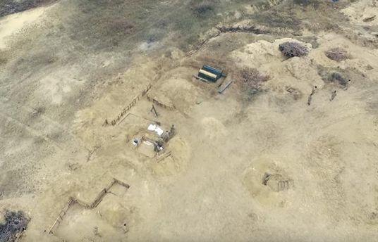 Съемка с воздуха испытания оружия