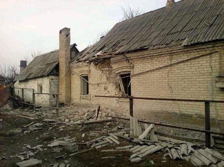 Обстрелянный дом