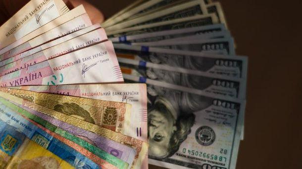 Нацбанк знизив офіційний курс гривні додолара на22 копійки