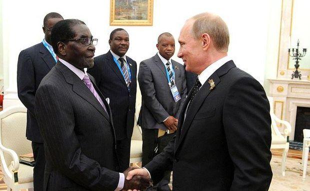 Путин и Мугабе